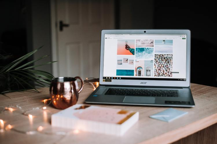 Laptop and mug of tea